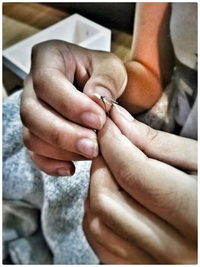 When I saw my daughter sew my clothes,I noticed she is almost grown up. Sewing Sewing Needle Sewing By Hand Human Hand Human Body Part Love Human Finger Indoors  Real People Close-up Care Lifeisbeautiful Life Day EyeEmNewHere