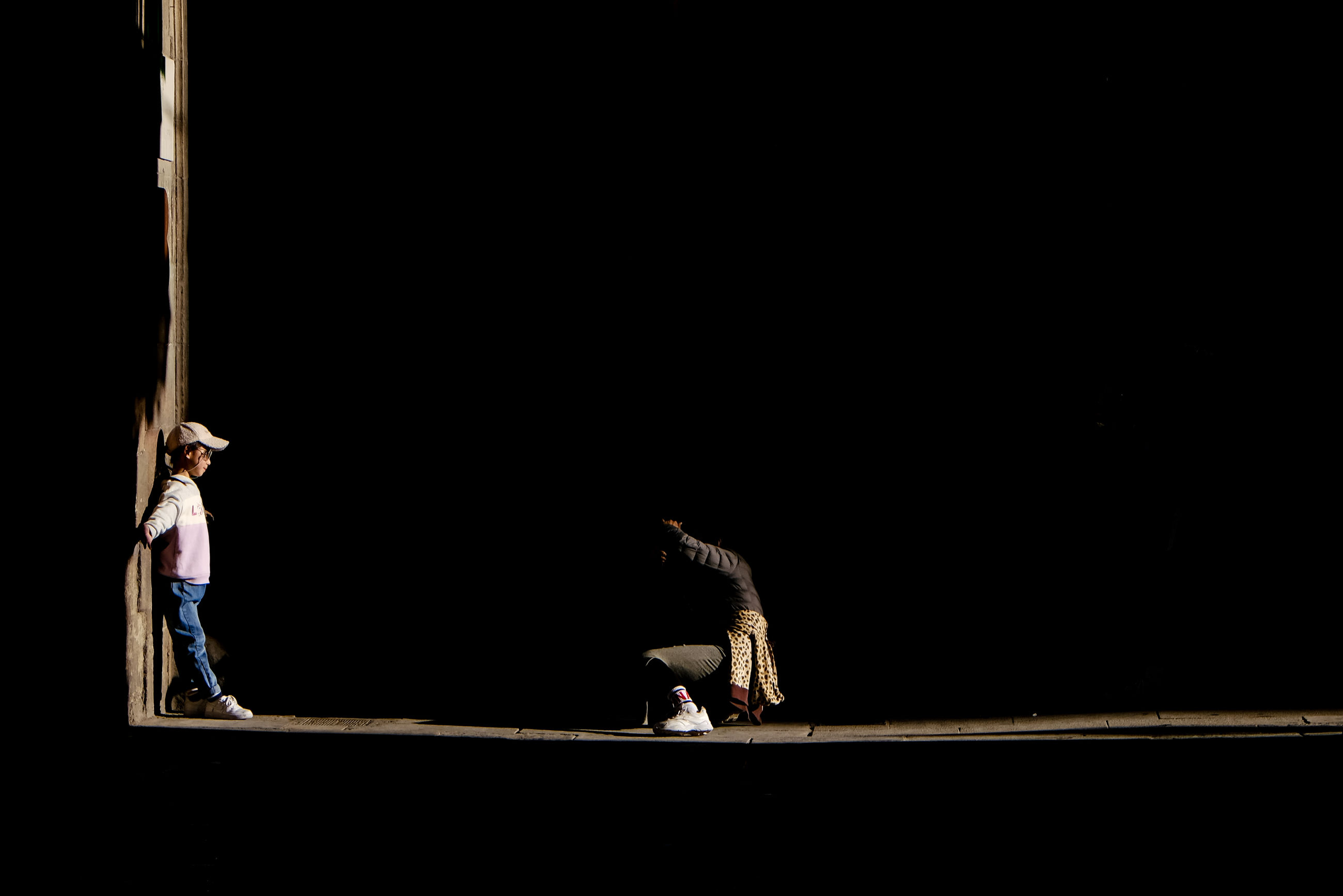 balance, skill, two people, full length, performance, real people, lifestyles, copy space, strength, arts culture and entertainment, flexibility, exercising, indoors, sport, people, women, practicing, adult, men, healthy lifestyle, black background, dark, stage, arms raised, human arm, effort, gymnastics
