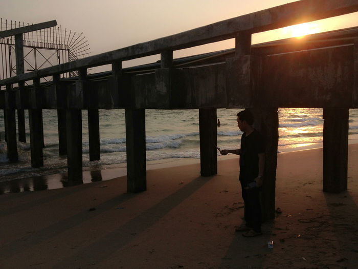 Architectural Column Architecture Beach Built Structure Clear Sky Day Full Length Horizon Over Water Indoors  Men Nature One Person People Real People Sea Sky Standing Sunlight Sunset Water