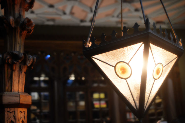 Lamp close-up at Lello Bookstore LelloBookstore Library Wood Focus On Foreground Indoors  Inside Photography Lamp No People Yellow Light