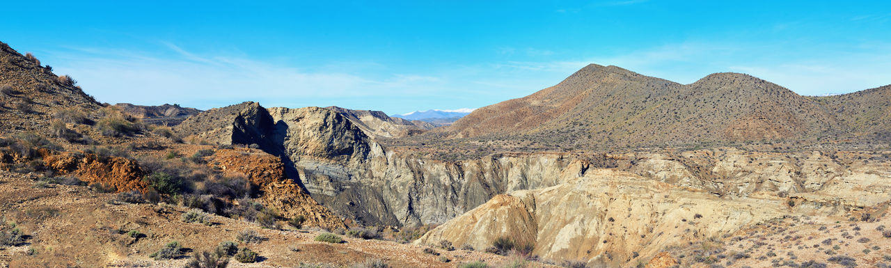 Panorama of Tabernas Desert, one of the most unique deserts of the world. The only European desert and one of the famous landmarks in Spain. Andalusia, Province of Almeria Almería Beauty In Nature Blue Sky Canyon Desert Europe Geology Landform Landmark Landscape Mountains Natural Park Nature Nature Backgrounds Panorama Panoramic Rock Rocky Mountains SPAIN Sunny Day Tabernas Tabernas Desert Travel Destinations Unique Valley