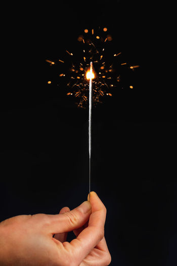 Sparkling stick isolated on black background