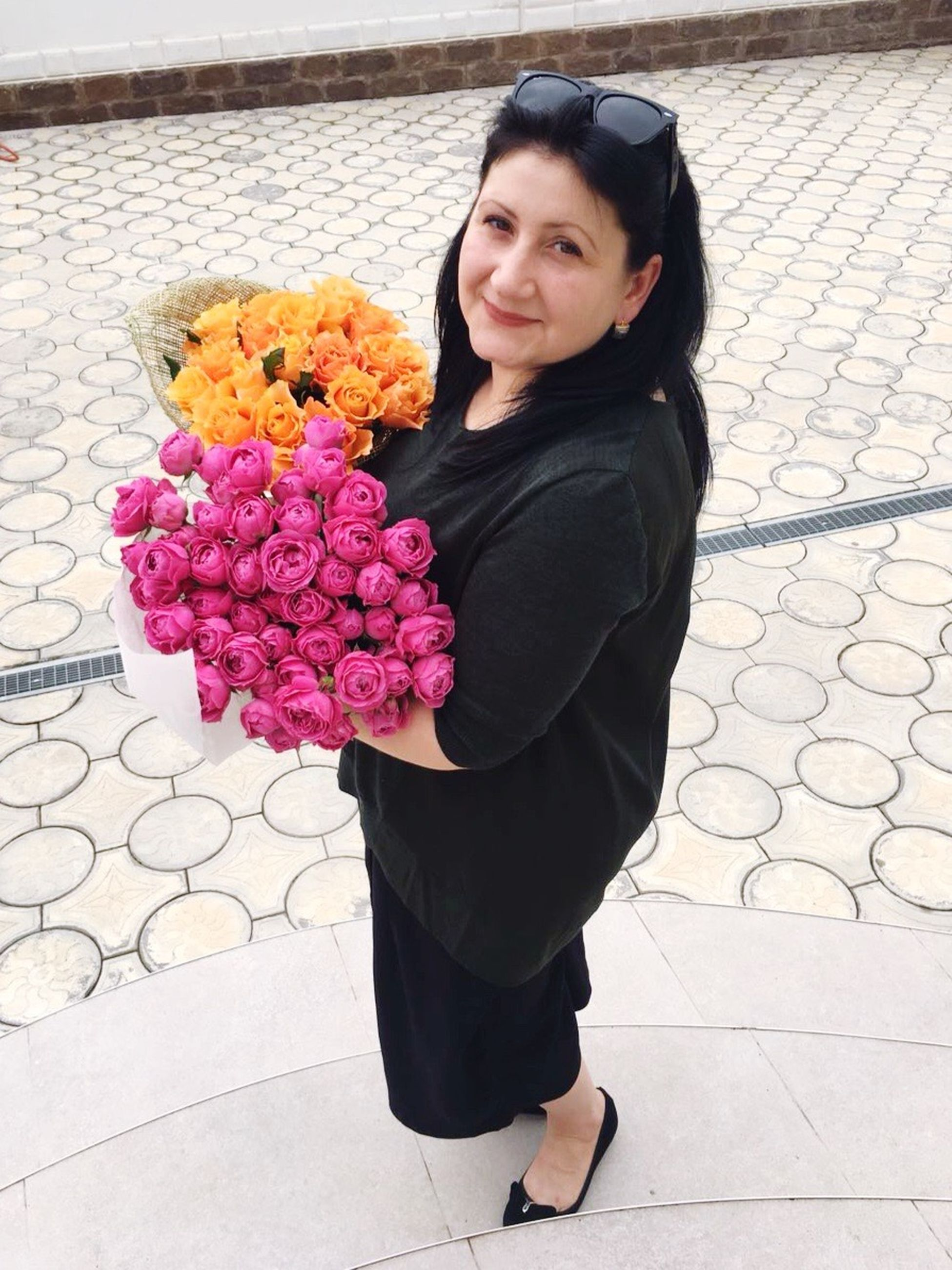 flower, full length, holding, bunch of flowers, standing, lifestyles, casual clothing, leisure activity, long hair, person, front view, freshness, bouquet, innocence, looking at camera