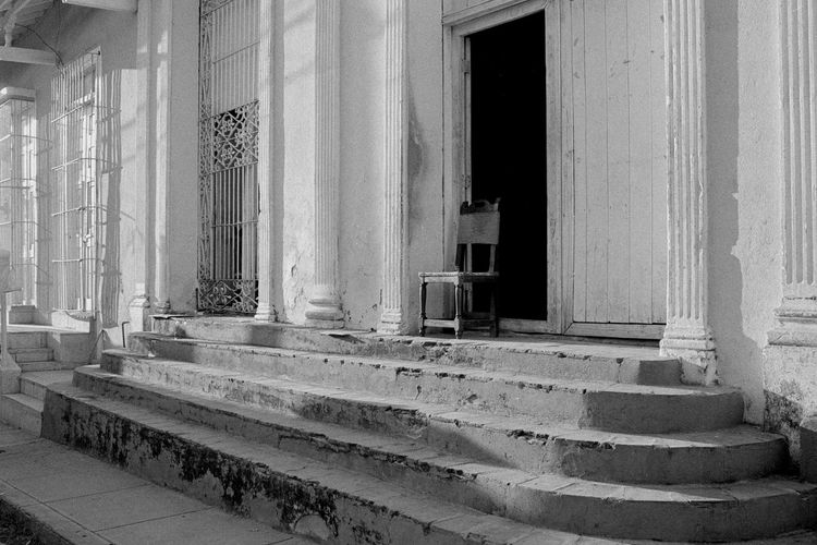 Awaiting Black And White Photography Blackandwhite Chair Emptyness Entrance Door Entrance Gate Film Film Photography Filmisnotdeath Mystery