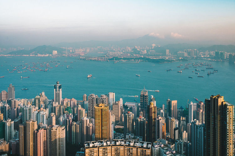 Hongkong, City of life . . . Aerial View Architecture Building Exterior Business City Cityscape Corporate Business Day Development Finance Growth Harbor High Angle View HongKong Modern Mountain No People Outdoors Sea Sky Skyscraper Sunset Travel Destinations Urban Skyline Water