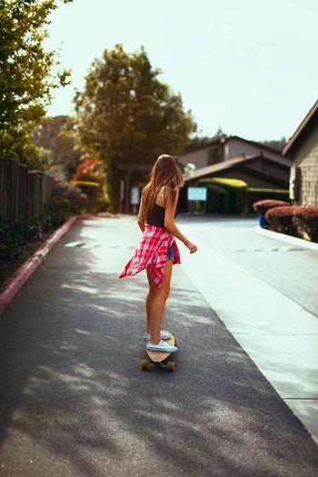 Full length rear view of girl jumping