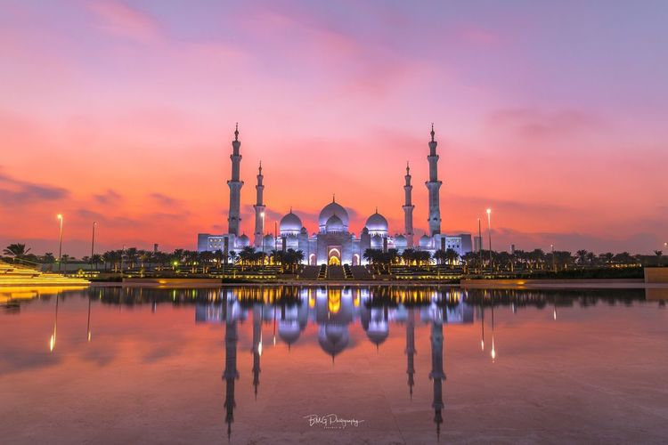 Sheikh Zayed Grand Mosque Built Structure Sunset Architecture Sky Building Exterior Orange Color Industry Travel Destinations Illuminated Water Religion Outdoors Night No People