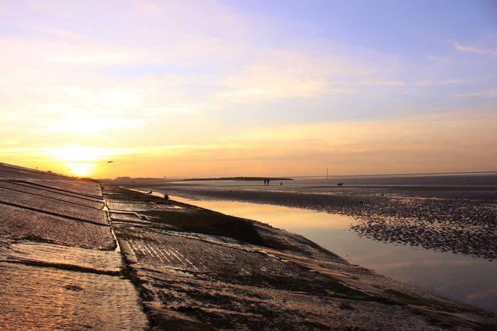 Promenade north Wallasey Walking On The Beach People Walking  Sunset Water Sea Scenics Beauty In Nature Nature Tranquil Scene Beach Tranquility Sky Sun Outdoors Reflection Sunlight Horizon Over Water Sand
