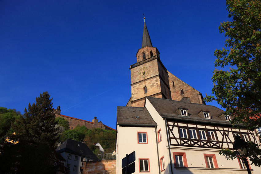 old city and church Petrikirche of Kulmbach, Frankonia, Bavaria, Germany Architecture Belief Blue Building Building Exterior Built Structure Clock Kulmbach Low Angle View Nature No People Outdoors Place Of Worship Plant Religion Residential District Sky Spire  Spirituality Tower Tree