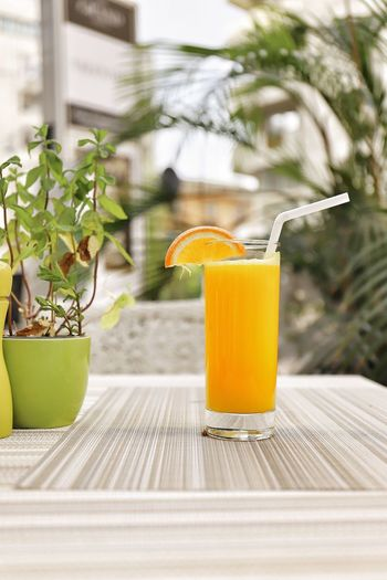 Orange Juice  EyeEm Selects Drink Food And Drink Refreshment Household Equipment Food Freshness Yellow Close-up Drinking Straw Drinking Glass Healthy Eating No People Glass Outdoors Straw Still Life Fruit Table Nature Day