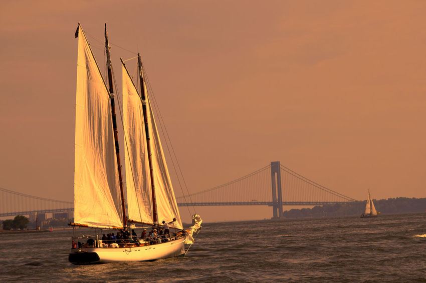 Newyork Ferry Ride View Architecture Bay Bridge Bridge - Man Made Structure Built Structure Connection Mode Of Transportation Nature Nautical Vessel No People Outdoors Sailboat Sailing Sea Sky Sunset Suspension Bridge Transportation Travel Travel Destinations Water Waterfront