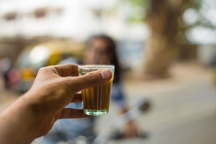 Cutting Chai Tea Adult Body Part Chai Tea Close-up Drink Finger Focus On Foreground Food And Drink Hand Holding Human Body Part Human Finger Human Hand Incidental People Indian Tea Indian Tea C Leisure Activity Lifestyles One Person Real People Refreshment Unrecognizable Person