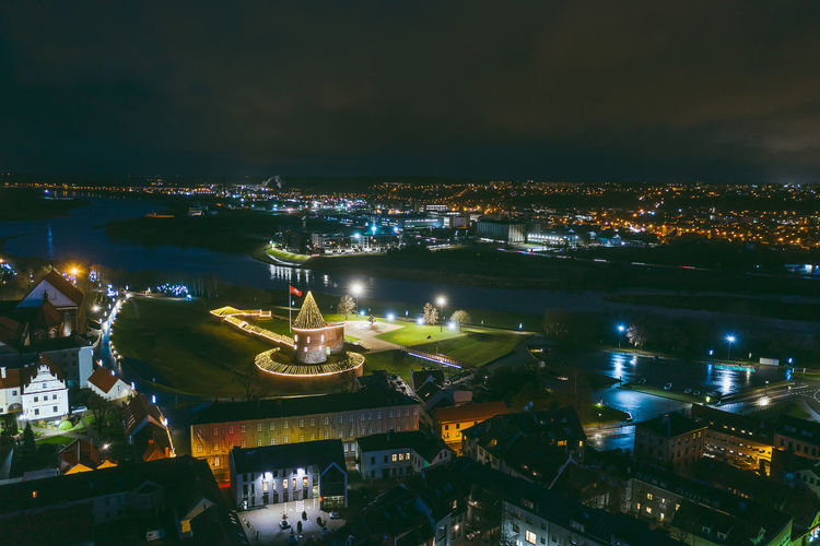 Kaunas old town Drone  Aerial View Aerial Mavic Mavic 2 Mavic 2 Pro Birds Of EyeEm  Europe Kaunas Old Town Night Building Exterior Illuminated Architecture City Built Structure Cityscape High Angle View Water No People Building Nature River Sky Residential District Outdoors Transportation Travel Destinations Travel Bay