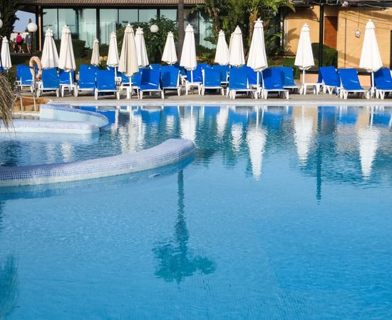 Blue Calm Day Deck Chairs Hotel Hotel Pool In A Row Mallorca No People Outdoors Pool Poolside Reflection Side By Side Standing Water Swimming Pool Travel Destination Vacation Water