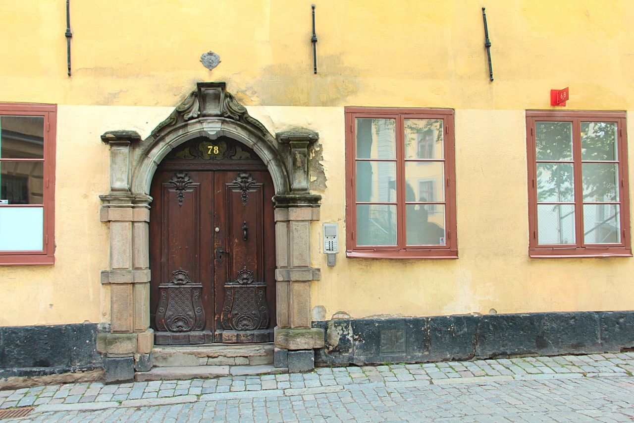 architecture, building exterior, built structure, door, entrance, building, closed, window, day, no people, security, residential district, house, protection, old, wall - building feature, outdoors, safety, front door, street