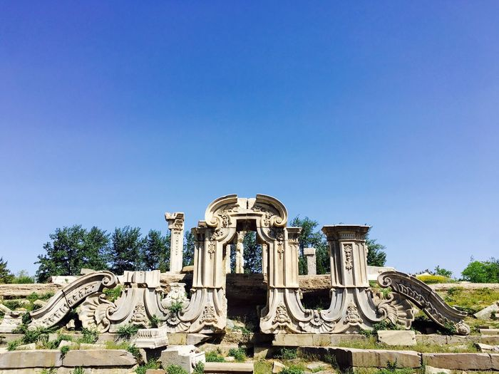 Old Ruins Of Summer Palace Against Blue Sky On Sunny Day