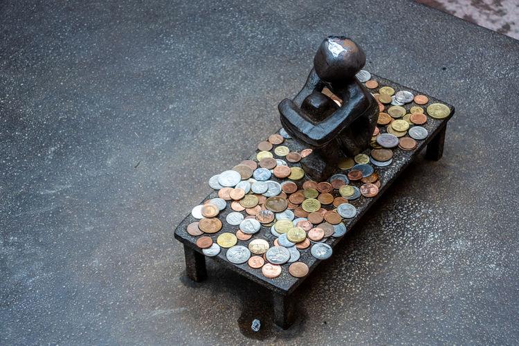 High angle view of coins on metal
