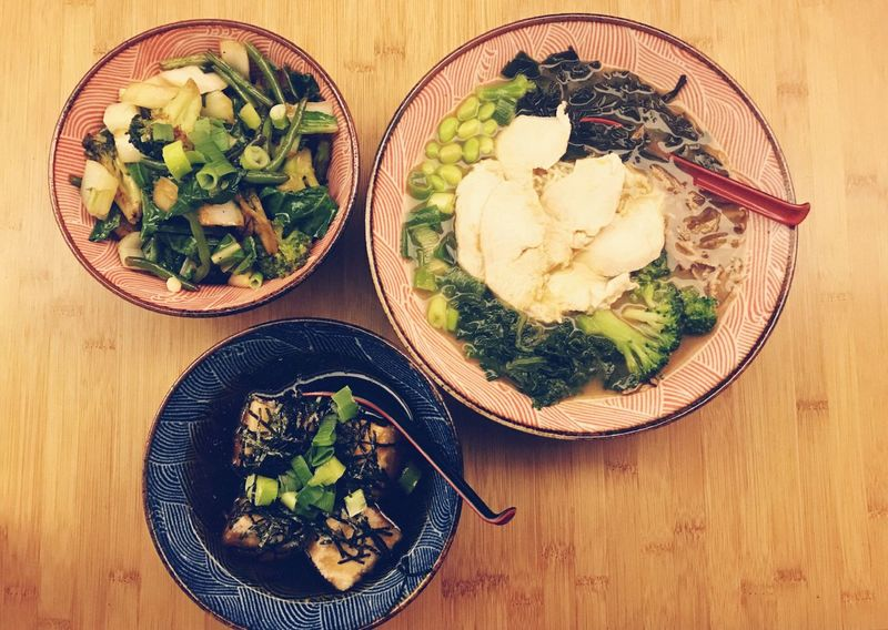 Fried greens tofu and chicken soup Food And Drink Vegetable Healthy Eating Bowl Indoors  Ready-to-eat Food High Angle View Freshness Table Serving Size Wood - Material No People Plate Tofu Soup Fried Greens Chicken Soup Chicken Bowls High Angle Day Close-up