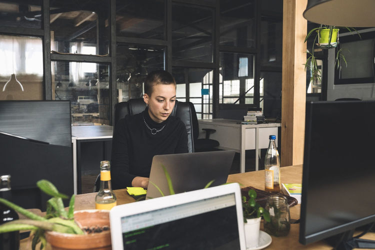 Man working on table in office
