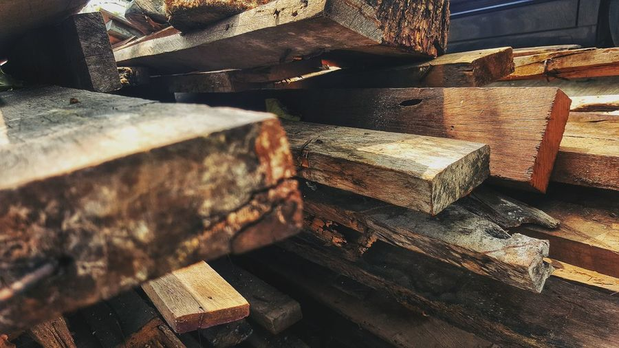 High angle view of old stack on wooden table
