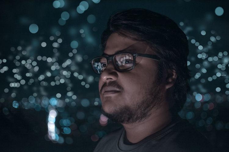 Close-up of young man wearing eyeglasses