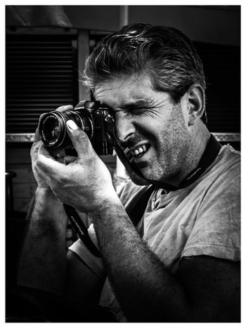 Smile for the camera Photography Themes One Person Real People Adult Adults Only Photographing One Man Only Only Men Close-up Technology Camera - Photographic Equipment Day People Men Blackandwhite NewHere ✌🏽️😄 Human Hand Human Body Part Smile ♥ EyeEmNewHere Small Business Heroes