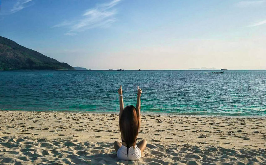 On the Sea Arms Raised Beach Beauty In Nature Horizon Horizon Over Water Human Arm Land Leisure Activity Lifestyles Nature One Person Outdoors Real People Rear View Sand Scenics - Nature Sea Sky Tranquil Scene Tranquility Water Women