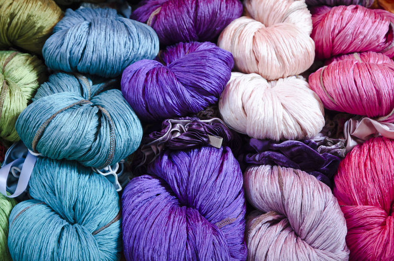 Multi-colored yarn unravel Abundance Arrangement Art And Craft Backgrounds Ball Of Wool Blue Color Close-up Colorful Day Fabrics Full Frame Green Color Indoors  Lila Color No People Pattern Pink Color Red Color Textile Textile Design Textile Industry Unravel Variation Variations Yarn