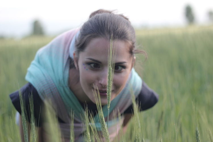 Portrait of mid adult woman in field