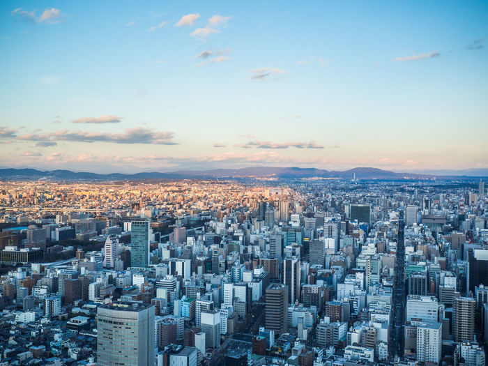 Beautiful aerial view of nagoya city in japan with tall buildings and blue skies