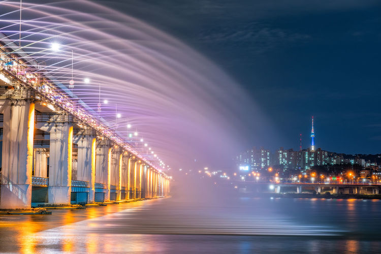 Rainbow fountain show at Banpo Bridge in Seoul, South Korea Landscape; Reflection Andmark; Watching; Moonlight Attraction; Crowd; Light; Water Cityscape; Attractive; Bright; Architecture Destination; Han; Sky; City; Asia; Famous Horizontal; Art Record; Beautiful; Design; Scene; Entertainment; Tourist;