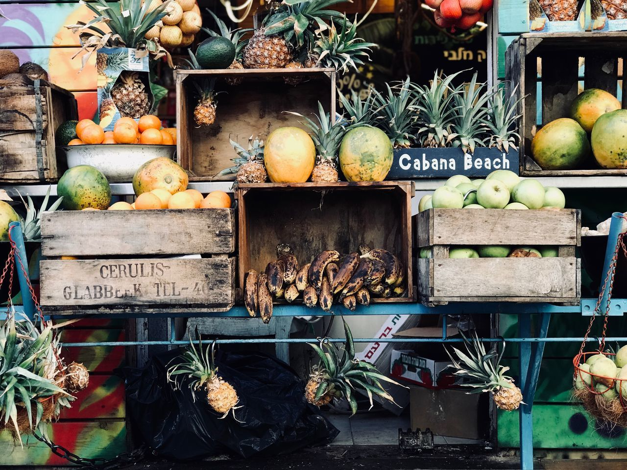 healthy eating, food and drink, retail, market, fruit, food, choice, communication, text, freshness, wellbeing, for sale, variation, large group of objects, market stall, no people, apple - fruit, day, western script, script, sale, retail display, outdoors