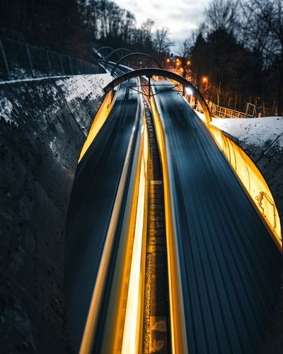 High Angle View Of Light Trails On Road During Winter