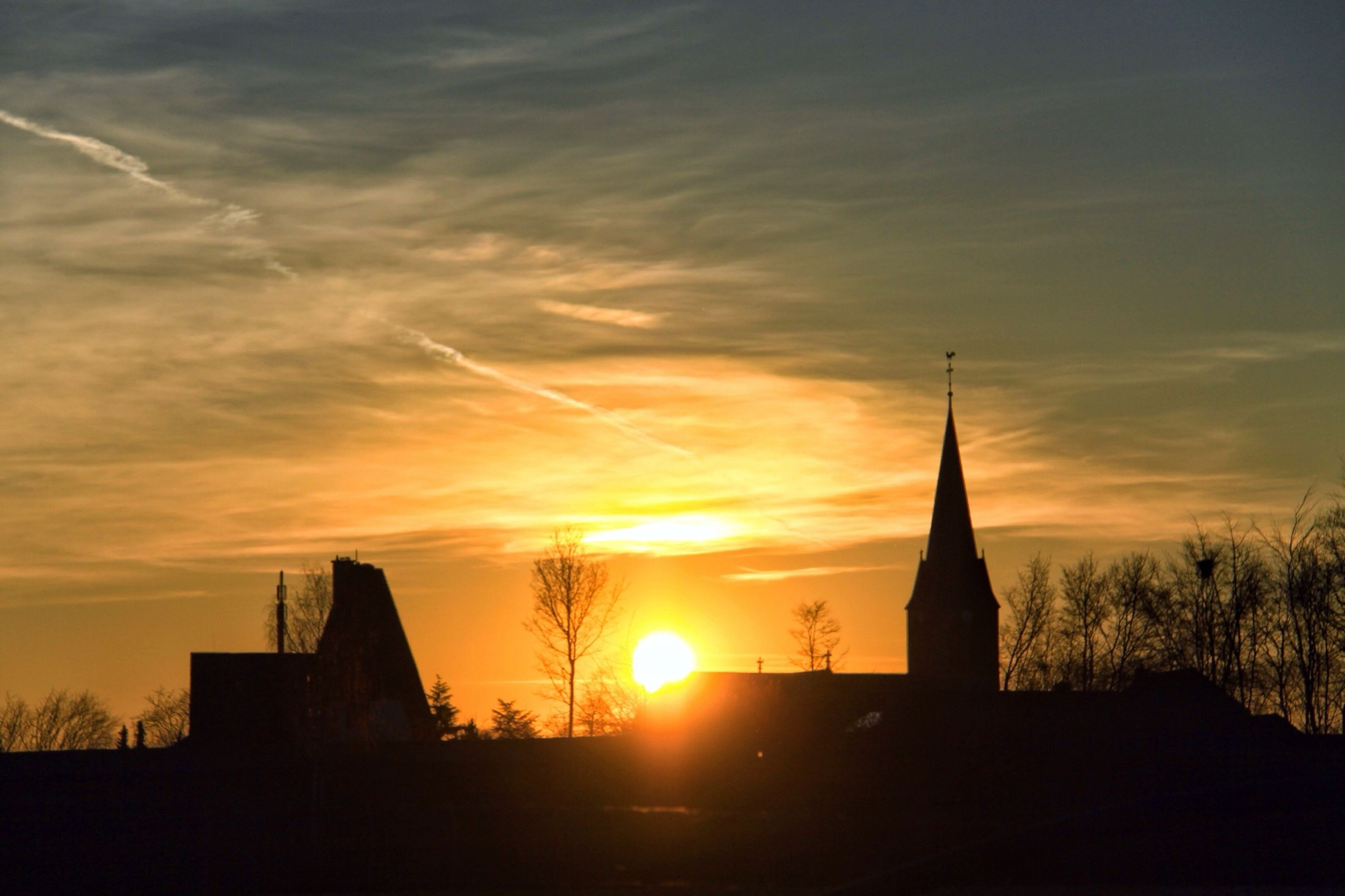 sunset, silhouette, architecture, building exterior, built structure, sky, place of worship, religion, sun, orange color, church, spirituality, cloud - sky, low angle view, tower, sunlight, cloud, outdoors