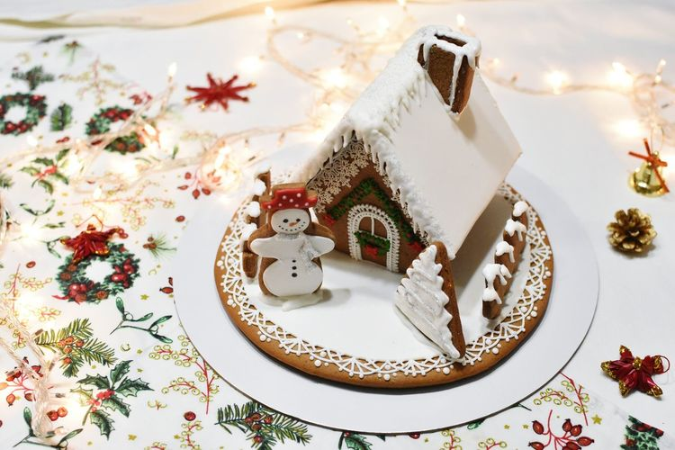 High angle view of gingerbread house on table
