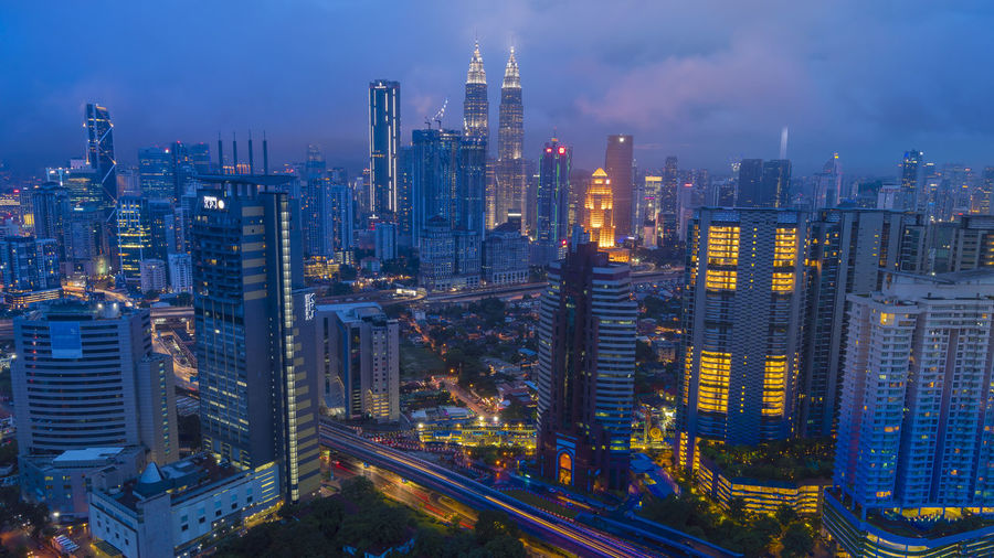 Cityscape of beautiful sunset at Kuala Lumpur, Malaysia Building Exterior City Office Building Exterior Built Structure Architecture Building Skyscraper Cityscape Modern Landscape Urban Skyline Tower Illuminated City Life Residential District Sky Office Travel Destinations Downtown District Tall - High Financial District  No People Outdoors