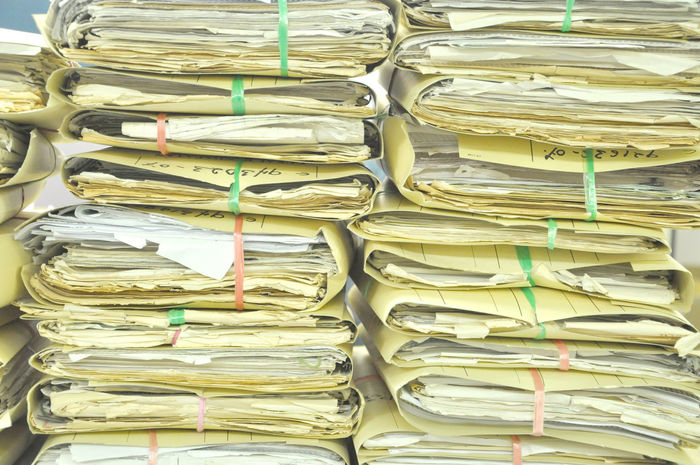 Stack Of Tied Old Files And Documents Yellowing On Office Floor A4 Antique Archives Bureaucracy Data Documents File Finance Folder Form Full Frame Information Mess Messy Note Old Outdated Papers Paperwork Pile Research Stacked Stationary Stored Yellowed