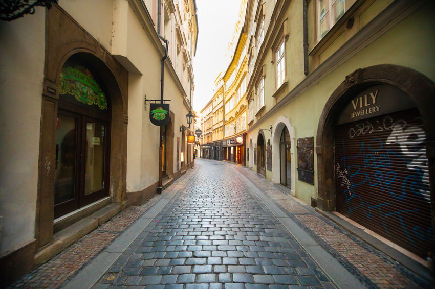 Czech Republic Prague Alley Arcade Arch Arched Architecture Building Building Exterior Built Structure City Cobblestone Day Diminishing Perspective Direction Electric Lamp Empty Footpath Lighting Equipment Narrow No People Outdoors Street The Way Forward Window