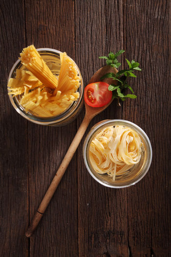 Tagliatelle with tomato and mint Food And Drink Meal Spaghetti Tagliatelle Bowl Carbohydrate - Food Type Directly Above Food Healthy Eating High Angle View Ingredient Italian Food Mint Leaf - Culinary No People Nutrition Pasta Preparation  Raw Food Still Life Tomato Wood - Material