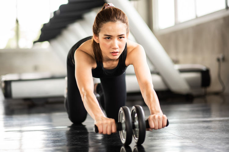 Adult Athlete Beautiful Woman Clothing Determination Effort Exercising Full Length Gym Health Club Healthy Lifestyle Human Arm Indoors  Lifestyles Muscular Build One Person Sport Sports Clothing Sports Training Strength Vitality Weight Weight Training  Young Adult Young Women