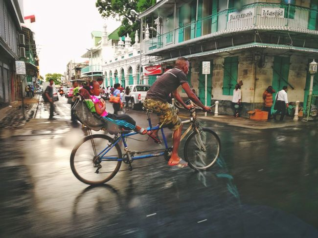 """""""I'm not rich but i know to live"""" Bicycle Mode Of Transport City Life Cycling Transportation City People Outdoors Indian Ocean EyeEm Best Shots Mauritius Photography Lifestyle Photooftheday Mauritian"""
