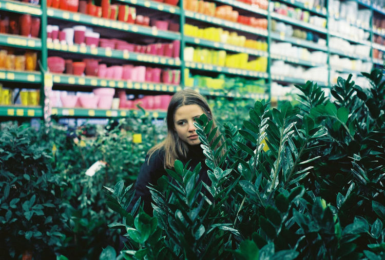 35mm Film Analogue Photography Film Green Green Color Ishootfilm Melancholic Plant Portrait Of A Woman Analog Beautiful Woman Film Photography Filmisnotdead Flora Flower Shop Girl Lifestyles People Plant Portrait Sad Store Women Young Adult Young Women