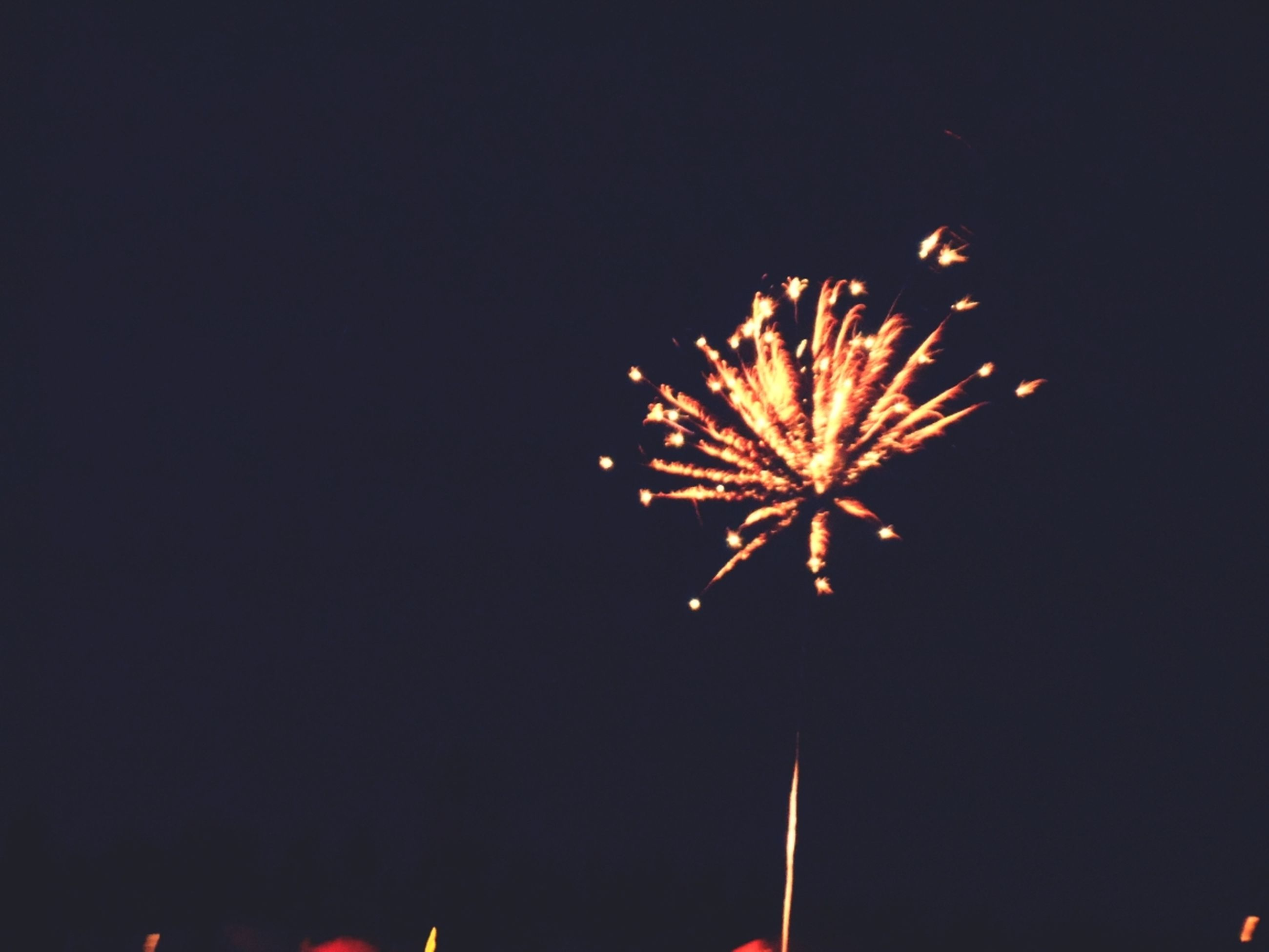 night, low angle view, celebration, firework display, illuminated, exploding, clear sky, firework - man made object, arts culture and entertainment, motion, long exposure, glowing, event, copy space, sky, firework, entertainment, red, sparks, celebration event