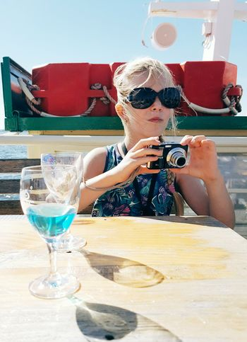 The next generation... Food And Drink Drink Table Refreshment Sitting Freshness Red In Front Of Summer Beverage Photographer Summer Holiday Child Camera Tourism Salzhaff Ostsee Baltic Sea Travel Wind Sun Boatride People And Places Blue Live For The Story