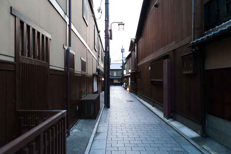 Alley amidst buildings in city