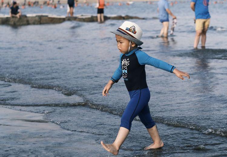 Full length of boys on beach