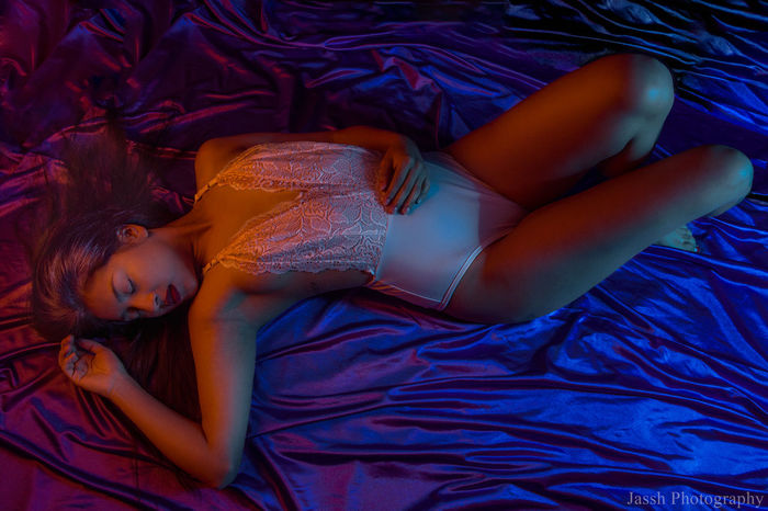 lying down at nigth Basque Country Boudoir Photography Colors Woman Beautiful Woman Beauty Bed Bedroom Blue Boudoir Day Full Length Indoors  Lifestyles Lying Down One Person Orange Color People Portrait Real People Relaxation Sheet Sleeping Young Adult Young Women