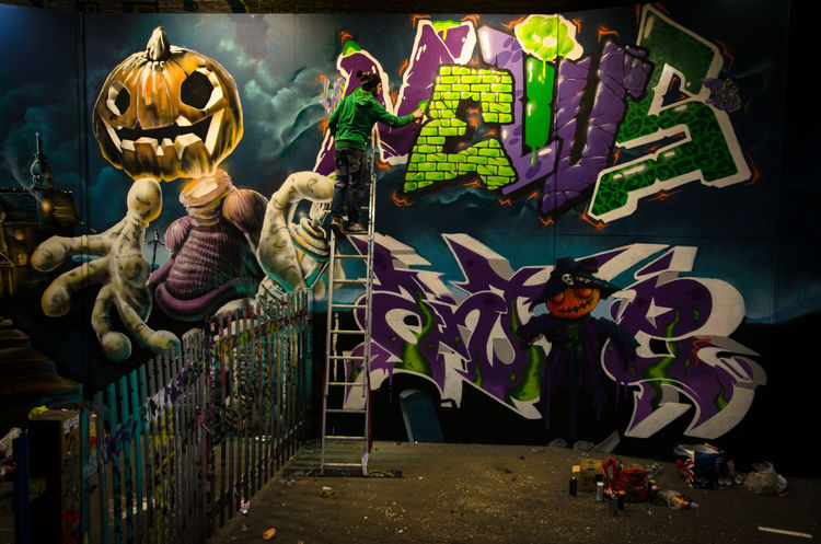 Halloween graffiti Alternative Climb Higher Creativity Expression ExpressYourself Graffiti Graffiti Artists Green And Purple Halloween Graffiti Halloween Pumpkin Halloween Pumpkins Holloween Ladder Leake Street Tunnel London London Lifestyle Look Up Urban Spay Spooky Street Artist Upper Level Waterloo Station Travel