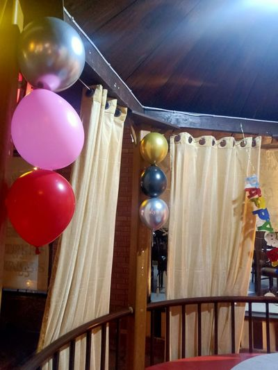 Low angle view of balloons hanging from ceiling