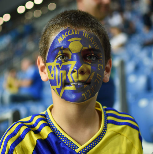 Portrait Of Soccer Fan With Face Paint
